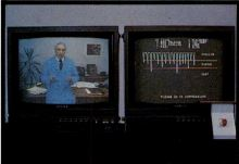 "The trainee's ""coach"" provides instruction and encouragement on the left monitor; the right shows the subject's vital signs as the simulation runs"