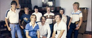 Early days in the garage at Origin. Top row, from left: Ken Arnold, Mike Ward, Laurie Thatcher, James Van Artsdalen, Helen Garriott, John Van Artsdalen. Bottom row: Richard Garriott, Robert Garriott, Chuck Bueche.