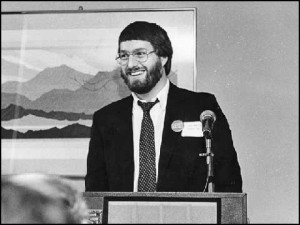 Steve Mereztky introduces the Infocom Hitchhiker's to a packed room inside Rockefeller Center, October 1984