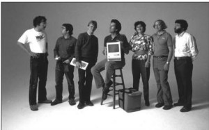 Much of the original Mac team: Bill Atkinson, Andy Hertzfeld, Chris Espinosa, George Crow, Joanna Hoffman, Burrell Smith, and Jerry Manock. Taking a leaf from Electronic Arts's playbook, Apple photographed them often in artful poses like this one during the Mac's initial promotional push.