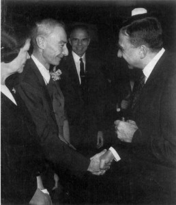 Robert Oppenheimer and Edward Teller share an uncomfortable handshake on the occasion of the former being awarded the Enrico Fermi Award, 1963.