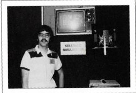 Joel with a single computer and a homemade sign at the June 1980 Origins gaming convention.