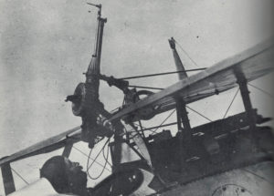 A French Nieuport biplane with machine gun mounted, less than ideally, above the pilot.