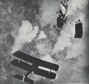 A British S.E.5a literally shoots a German Fokker to pieces.